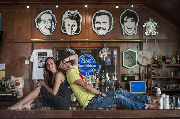 Heather & Wes on the famous bar at Hang Fire - GEOFF L. JOHNSON