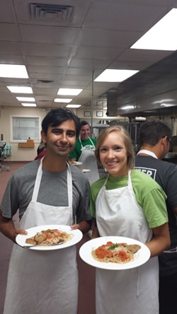Mercer Medical College students practice in the kitchen.