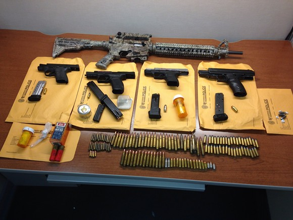 The seized guns and drugs
