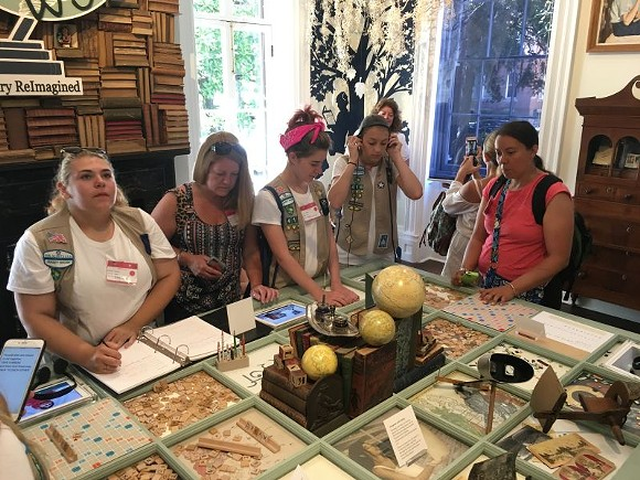 """A Girl Scout troop from New Jersey explores the interactive installation, """"A Library ReImagined,"""" at the Juliette Gordon Low Birthplace, also known as """"Girl Scout Mecca."""""""