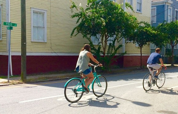 What did drivers get when their ability to travel 20 mph above the speed limit was curtailed by the Price Street bike lane?  A safer street.