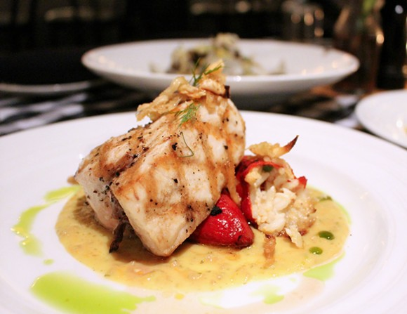 Swordfish steak with sweet piquillo peppers stuffed with crab and rice along with toothsome candied fennel and ripe yellow tomato coulis.