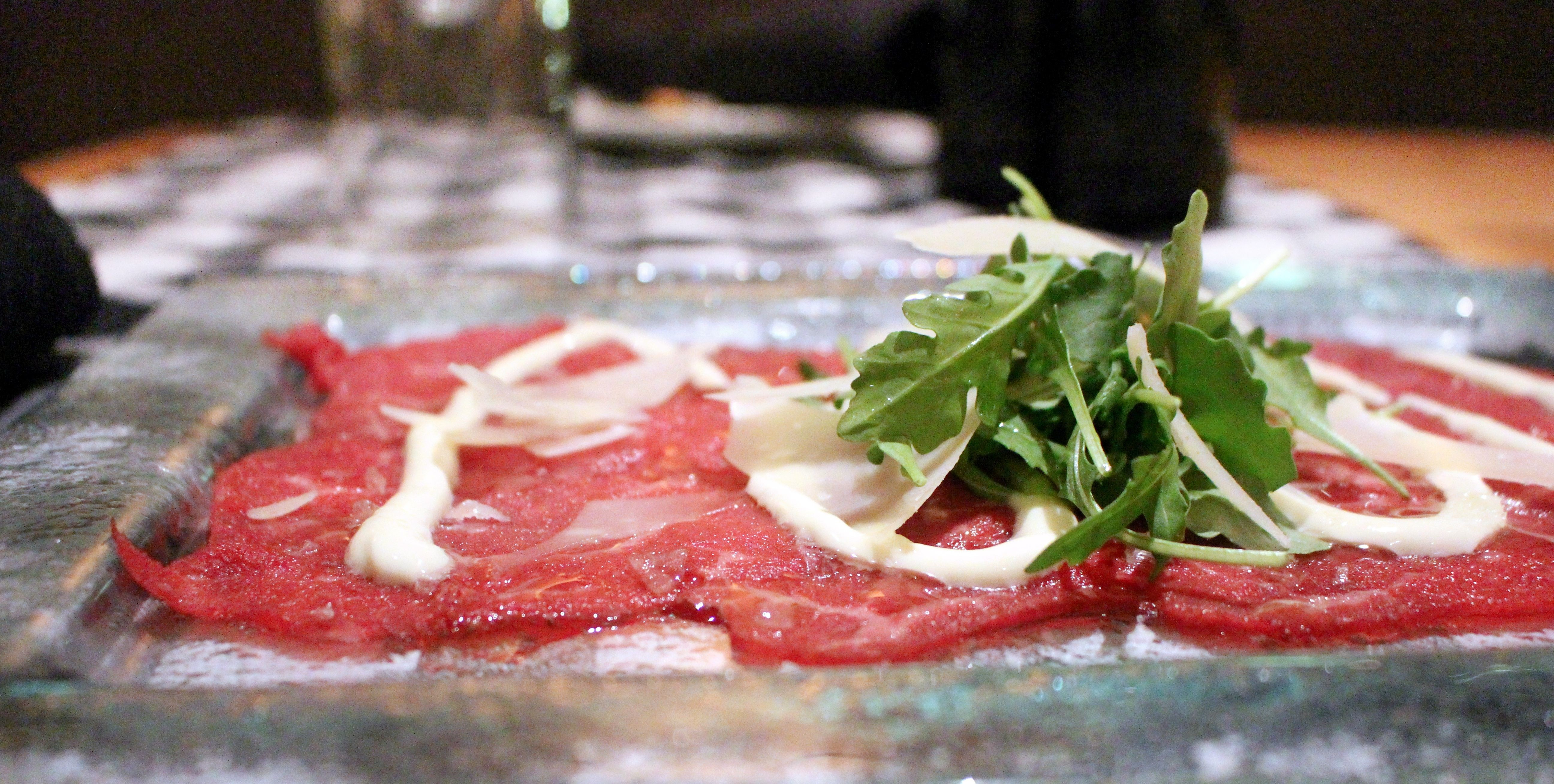 Beef Carpaccio, one of Pacci's signature dishes, from which the restaurant's name is derived.