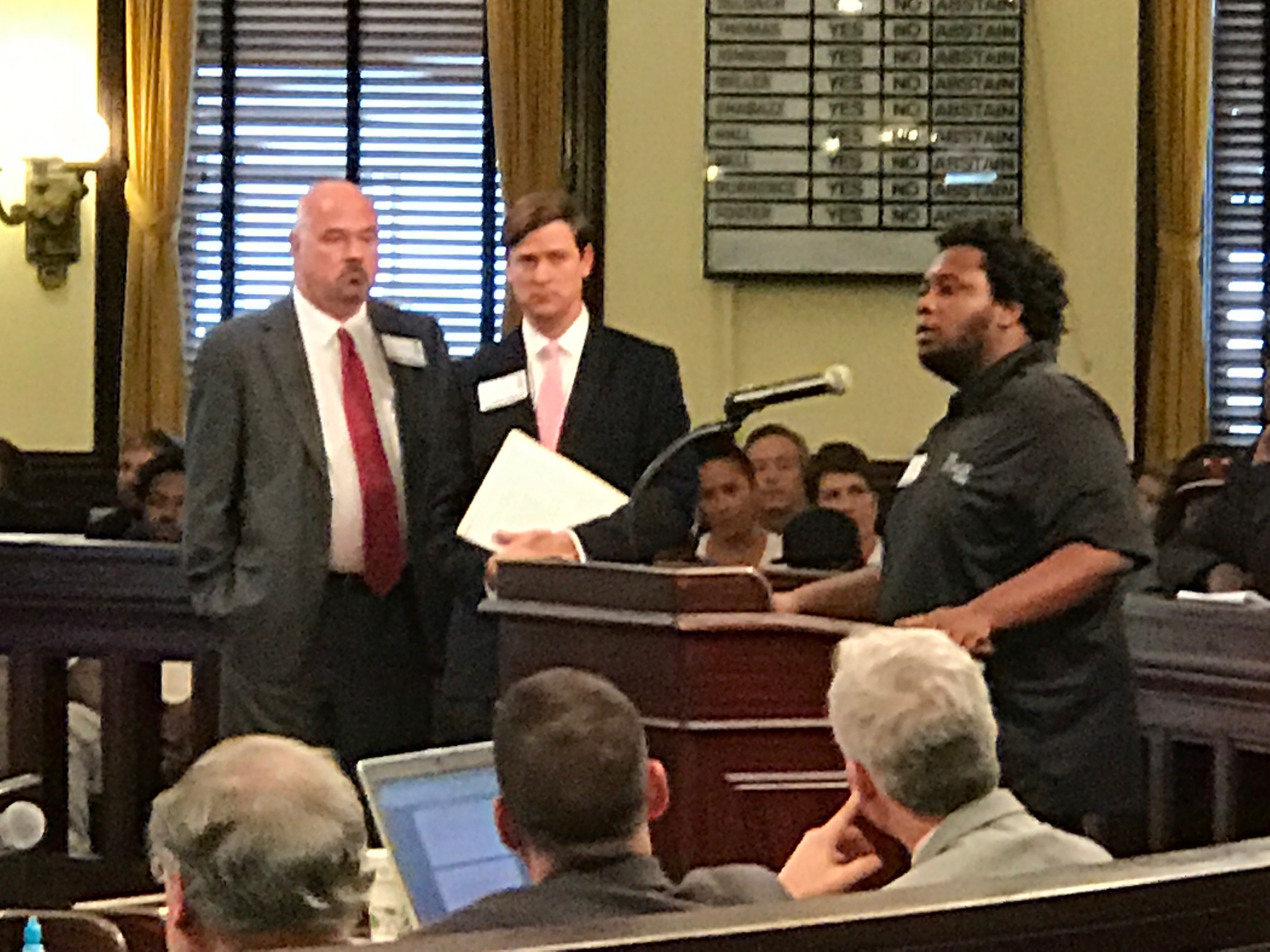The Stage On Bay owner Charlie Schmitt stands with attorney Will Claiborne as West Savannah resident Charles Brown speaks in support of the project at today's City Council meeting.