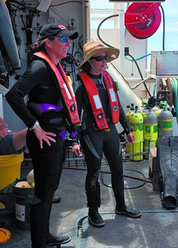 Chief scientist Kim Roberson (left) oversees operations and makes twice daily dives to collect data and specimens. - PHOTO BY JESSICA LEIGH LEBOS