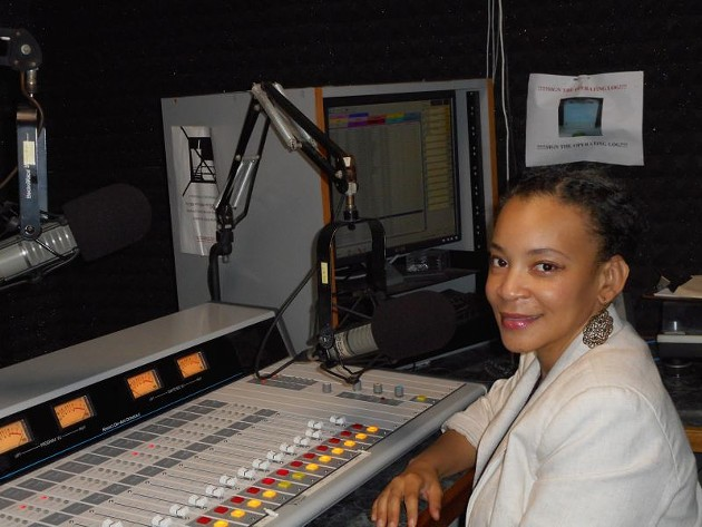 Station Manager Grace Curry at the console