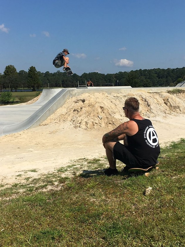 Maher watches Justin Kesler catch air over one of the park's basins. - JESSICA LEIGH LEBOS