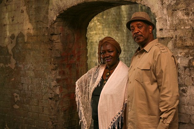 "Sistah Patt and her business partner and cousin ""Gullah Mike"" Washington stand in the Cluskey Vaults, built in 1842 for unknown purposes. - PHOTO BY JON WAITS"