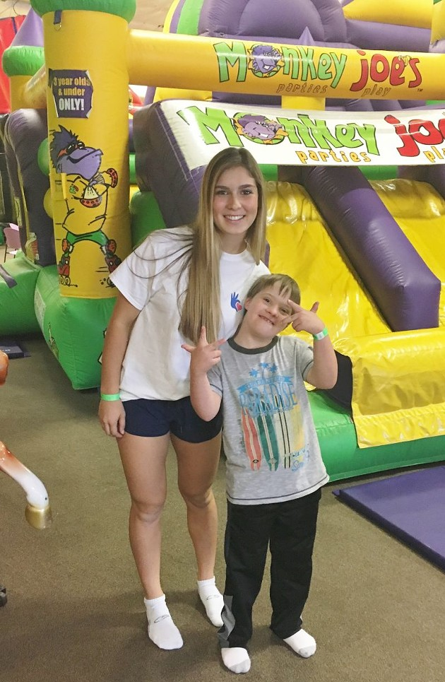 UTime founder Lily Glass clowns around with special friend Ethan Shrek.
