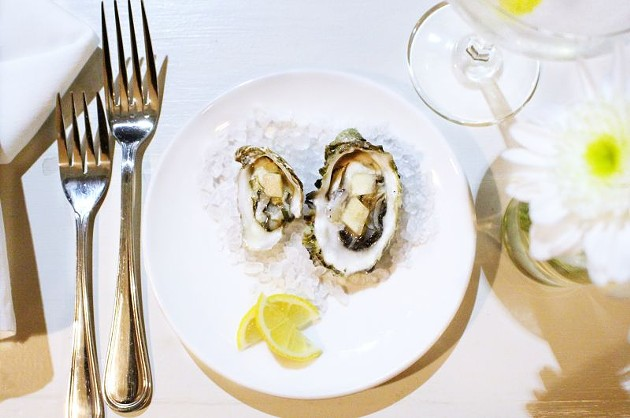 Fresh oysters from the east and west coast are served with a pickled watermelon rind.