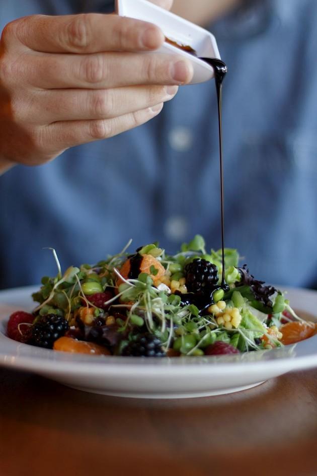 The salad has plump berries, feta, edamame, and a coating of balsamic dressing.