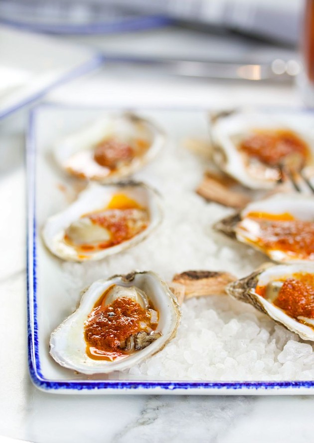 Roast Barbeque Oysters are crowned with bourbon smoked jalapeno butter