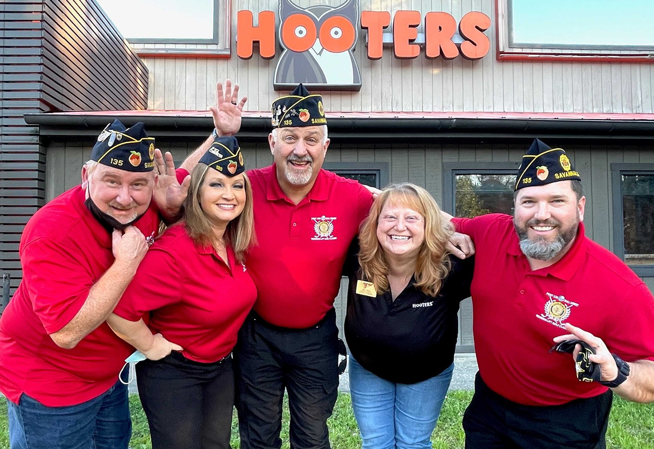 Members of the American Legion Post 135 celebrate Hooters' sponsorship of this year's event.