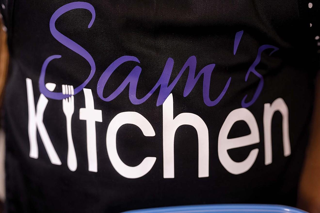 An apron displaying Sam's Kitchen.
