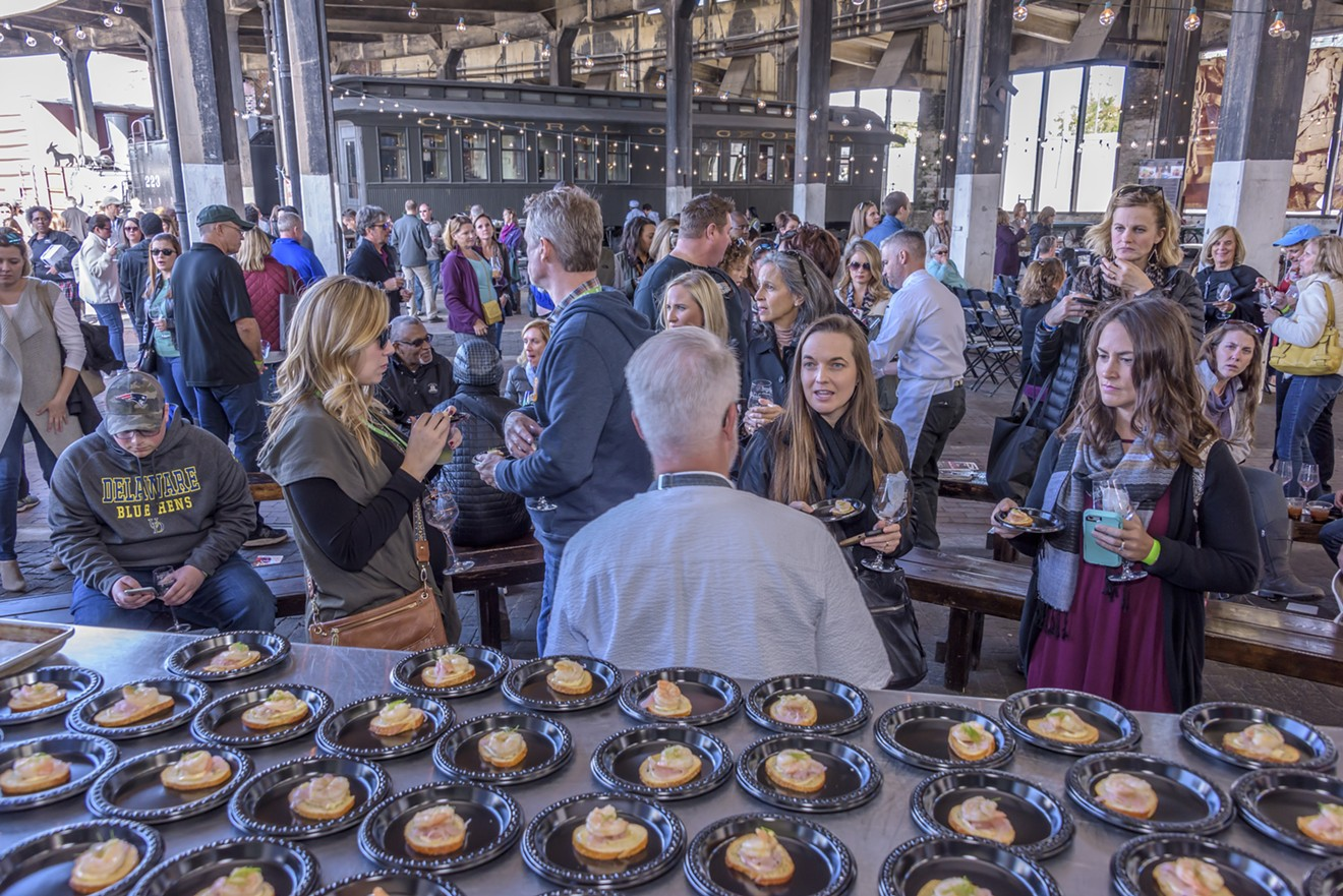 Festival goers at a previous year's Food and Wine festival enjoy the diverse pairings and crowd setting.