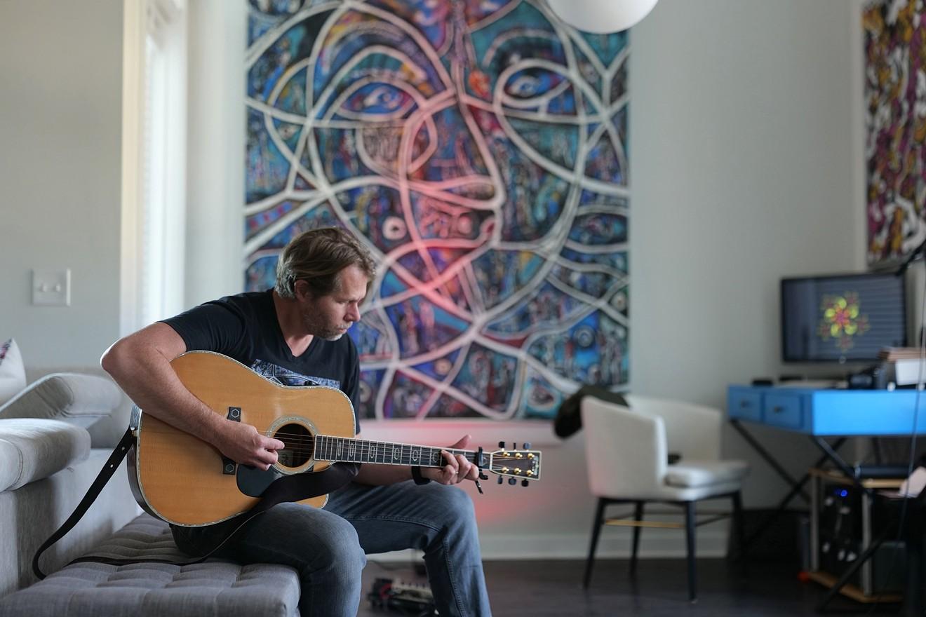 Charles Maring focuses on performing his songs.