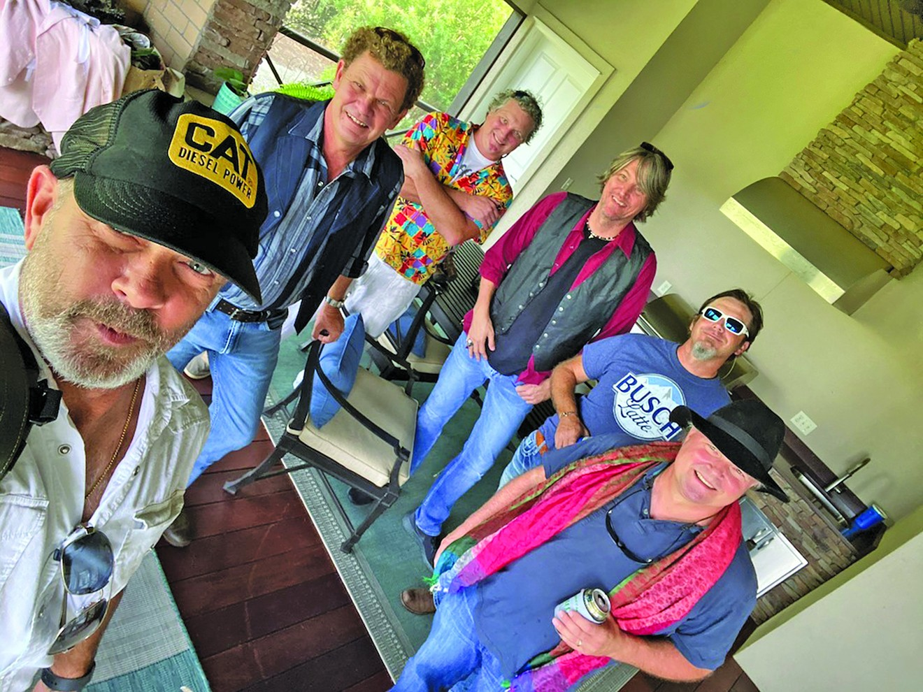 Members of Monkey Man: A Stones Band prepare for their upcoming concert at Starland Yard.