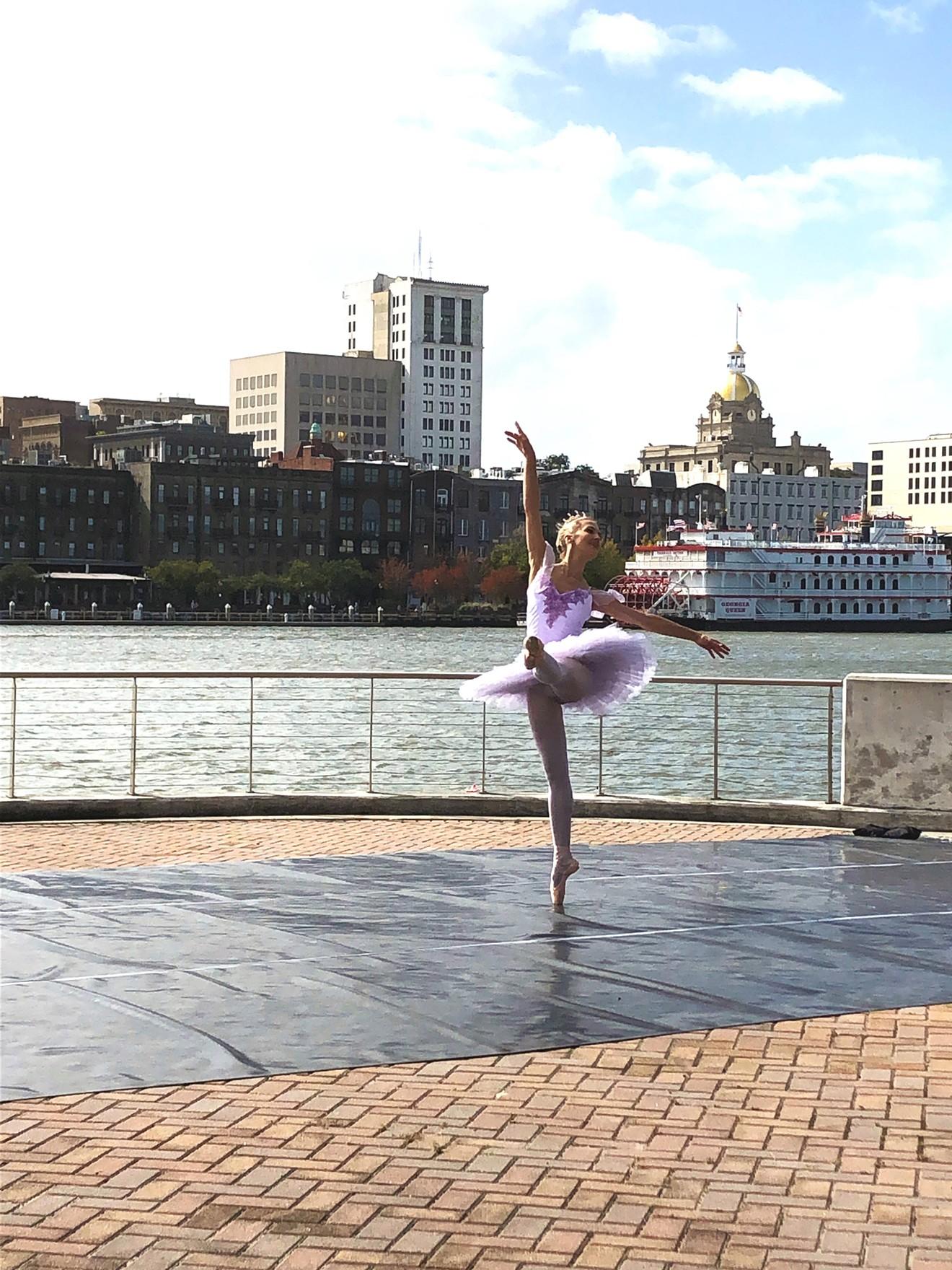 A member of Savannah Ballet dances on River St.