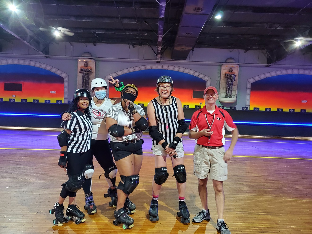 Rollerderby referees and coaches gather in the rink as they prepare for the upcoming season. Open enrollment for the Jr. Derbytaunts runs through the end of August.