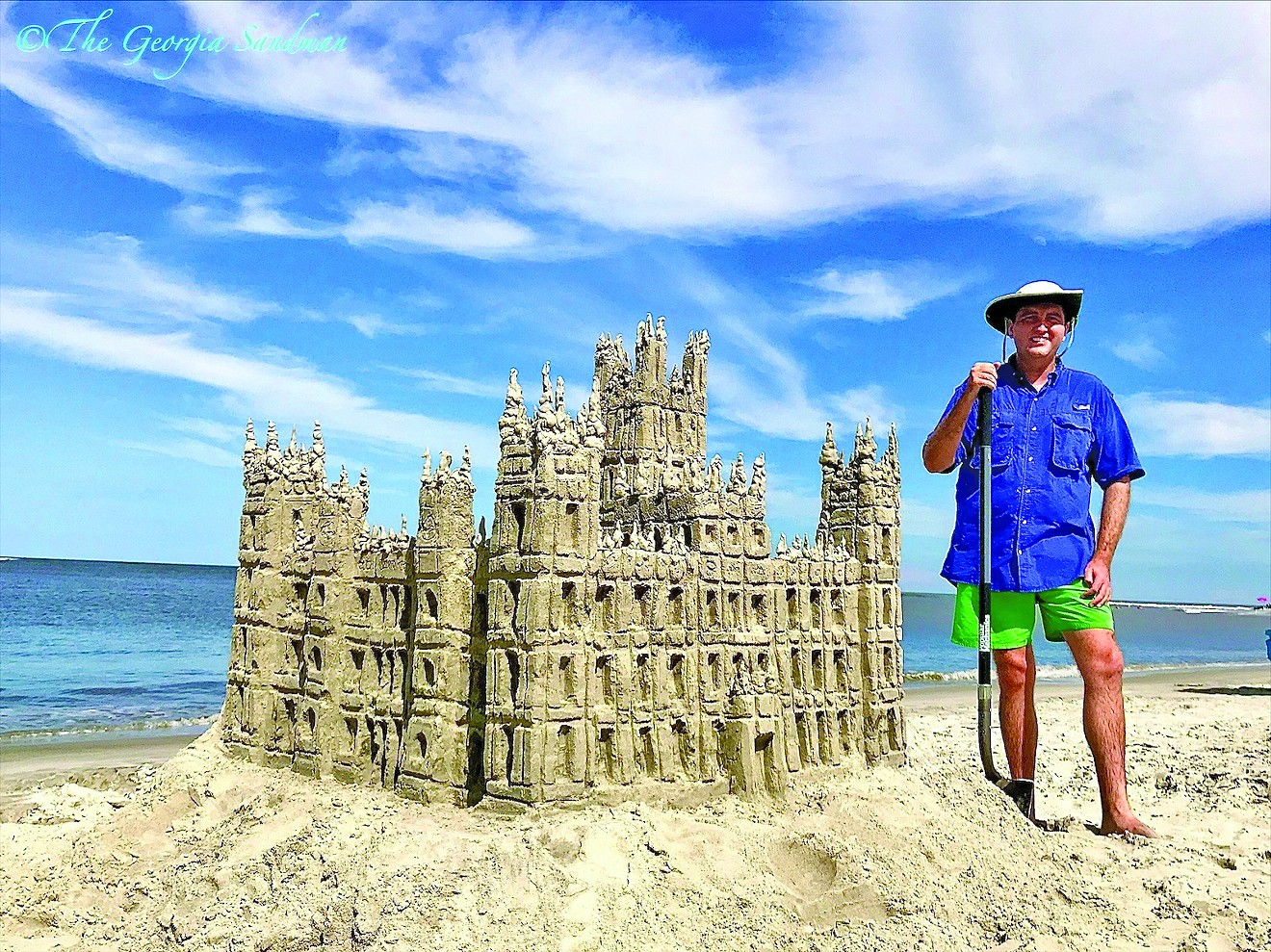 """""""The Georgia Sandman"""" Dylan Mulligan poses with one of his favorite sand-builds, Highclere Castle, the famous dwelling from the hit television program """"Downtown Abbey."""""""