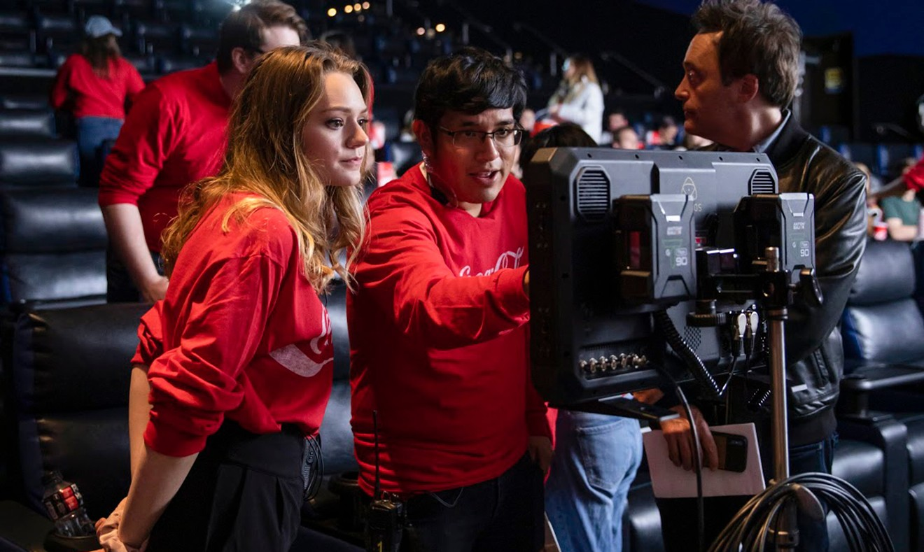 (L-R) Olivia Schneider (SCAD senior, film and television); Henry Zhinin (senior, film and television); and Professor Brett Wagner (associate chair, film and television) reviewing set up in-between takes.