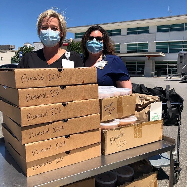 Nurses with their delivered lunches.