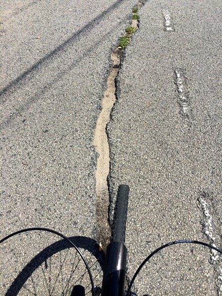 Danger in the bike lane: If your bike's front wheel becomes stuck in this massive crack in the Lincoln Street bike lane, you're going to have a bad time.