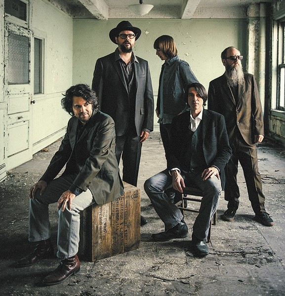 Patterson Hood (standing, with hat), and The Drive-By Truckers play the Trustees Theatre next week.