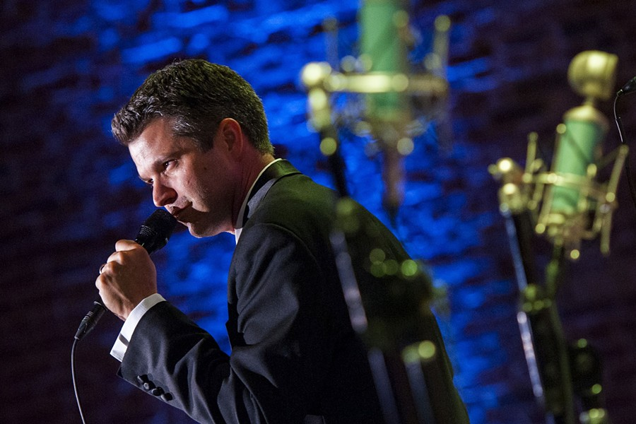 Clay Johnson croons for the crowd. - PHOTO BY GEOFF L. JOHNSON