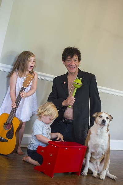 Keith with his children, Zeila and Wolfgang, and the family pup. - GEOFF L. JOHNSON