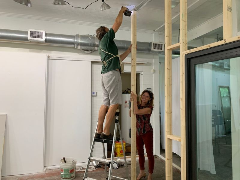 Meg Kelly Schroeder with her husband, Todd, building out the set.