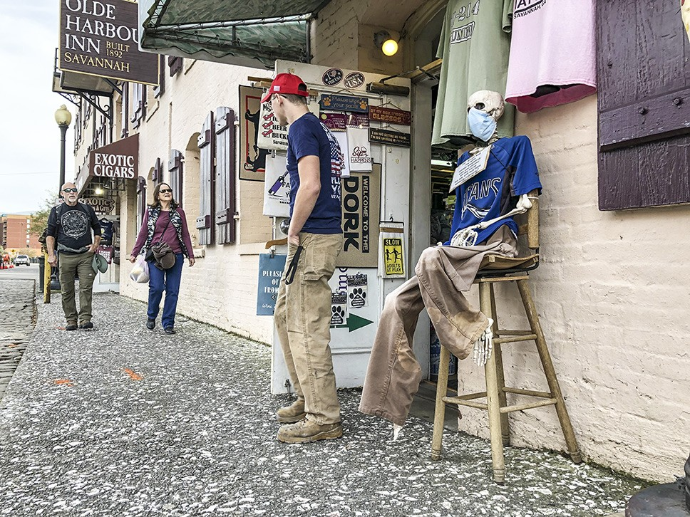 Savannah visitors on River Street ignore Mayor Johnson's emergency order to wear face masks in public spaces.