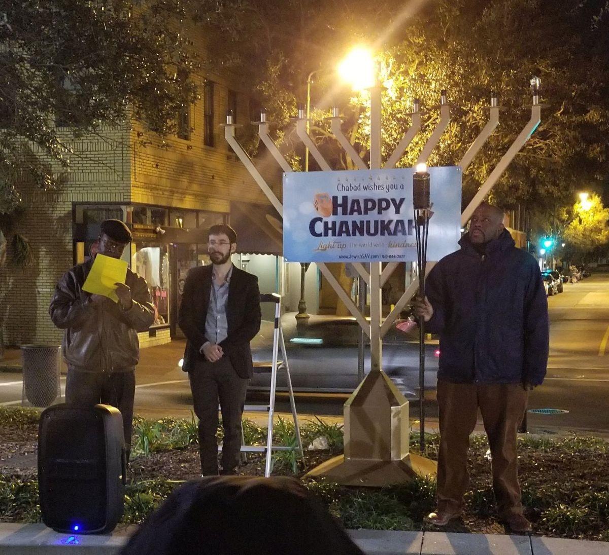 Savannah Mayor Van Johnson (right) participates in the 2017 menorah-lighting ceremony in Ellis Square during Chanukah 2017.