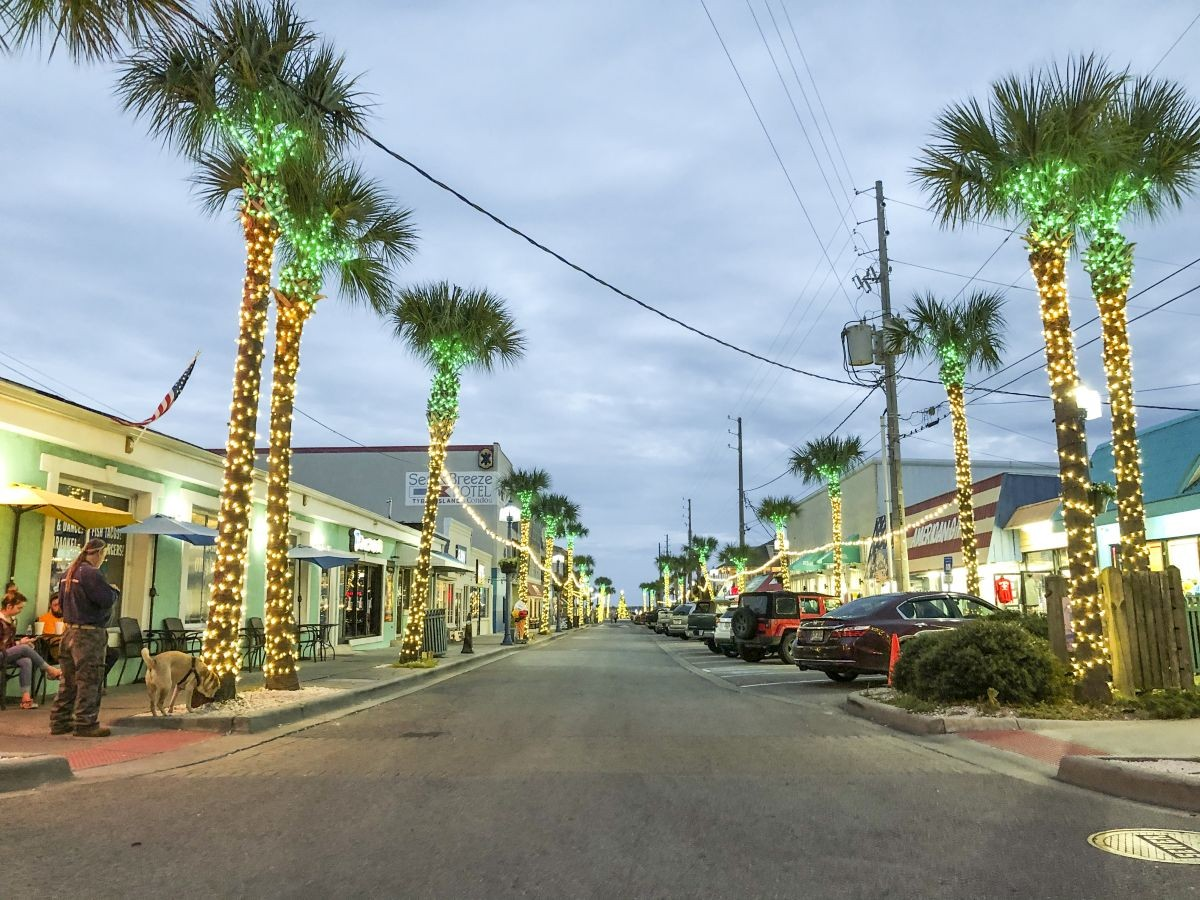 The palm trees lining Tybrisa Street are bedecked with brilliant bulbs.