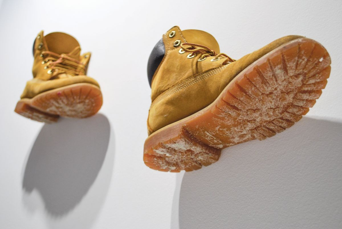 Artist Nikki Zuaro's work boots are displayed as part of her (f) Utility exhibition at the Cedar House Gallery.