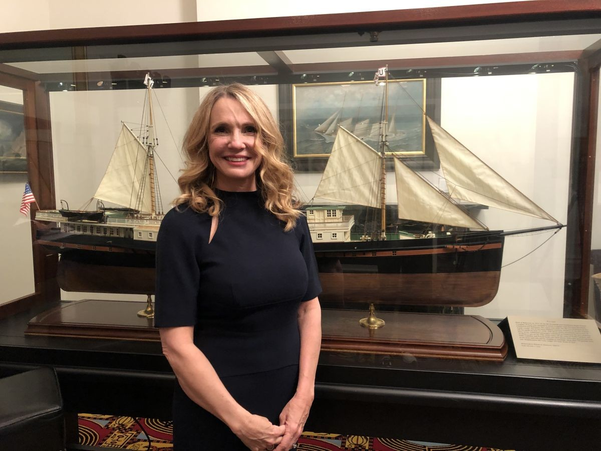 Patti Callahan Henry stands with a model ship March 9 in the Maritime Museum.