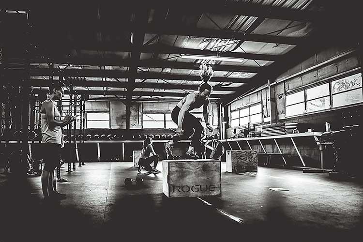 Sophia Hofeling completes burpee box jump overs at River Drive Crossfit gym.