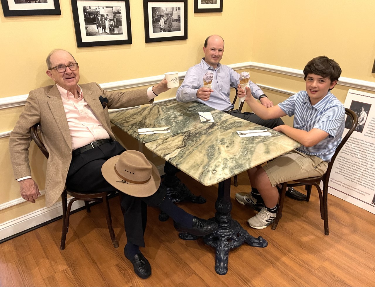 Charles H. Morris, left, enjoys the new Connecting Savannah Legacies ice cream flavor with Charles H. Morris Jr., son, and Charles Morris, III, grandson.