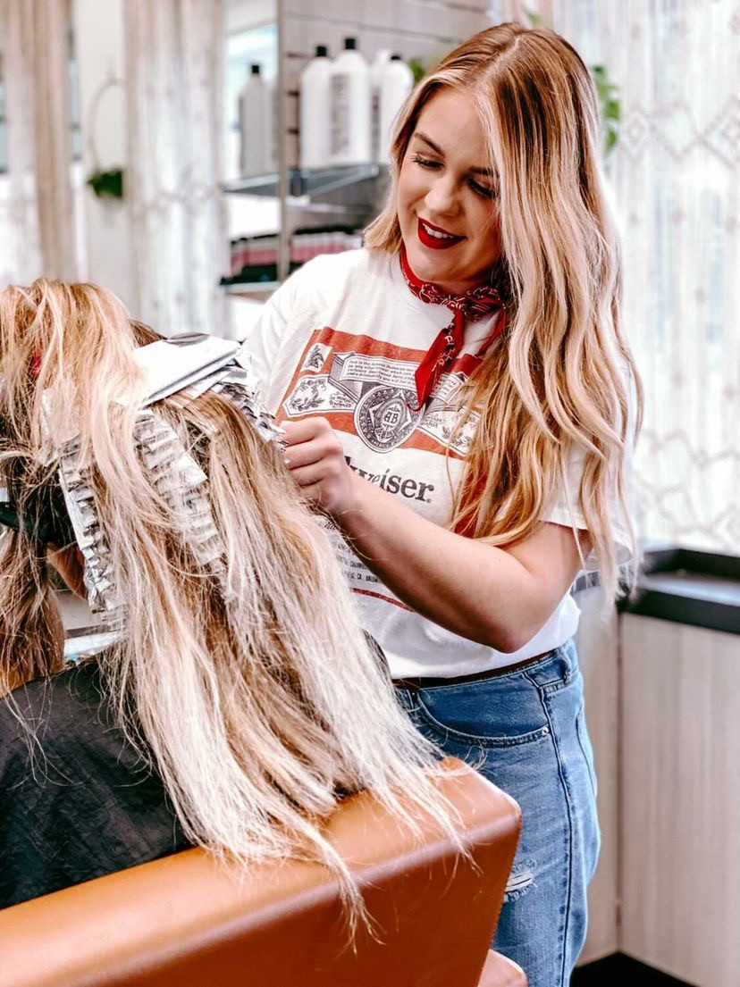 Katie Oakes, Hair by Katie Oakes Salon Studio and Sola Salons, works on clients' hair at her studio.