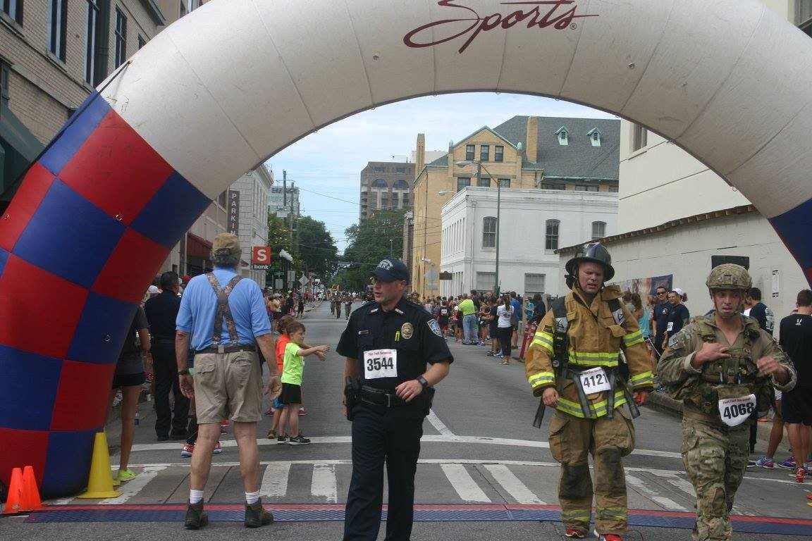 Race participants cross the finish line at a previous year's Run for Heroes.