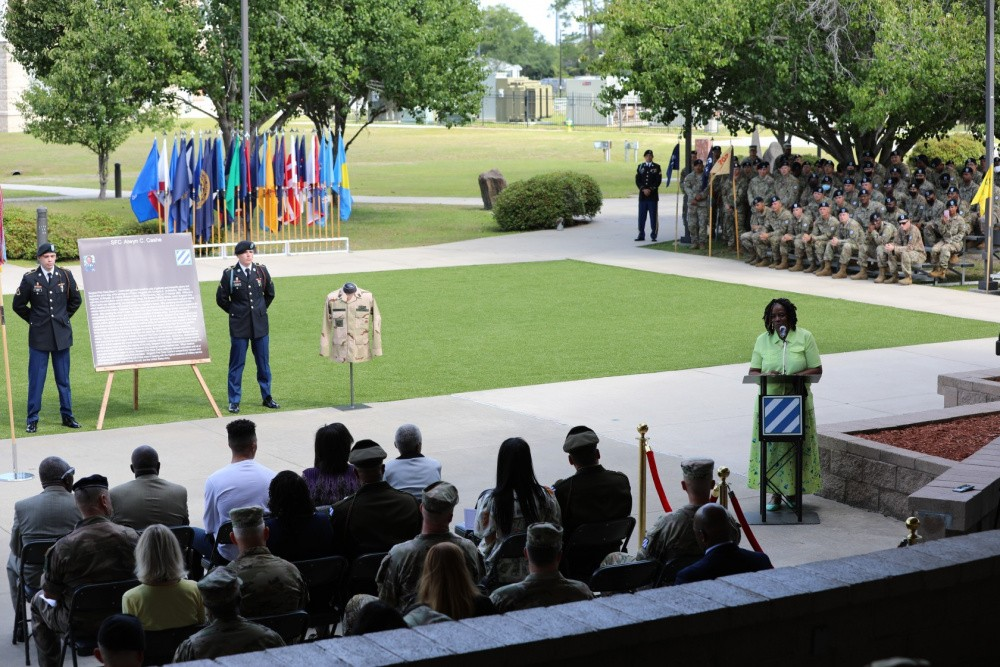 Kasinal Cashe White, the sister of Sgt. 1st Class Alwyn C. Cashe, delivers a speech during the Cashe Garden dedication ceremony on Fort Stewart, Georgia, May 20.