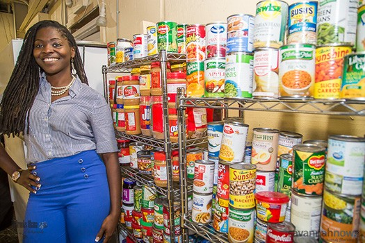 """""""Lady Mahogany"""" Bowers stands among donations from the community as a showing of her dedication to her cause to feed children in need."""