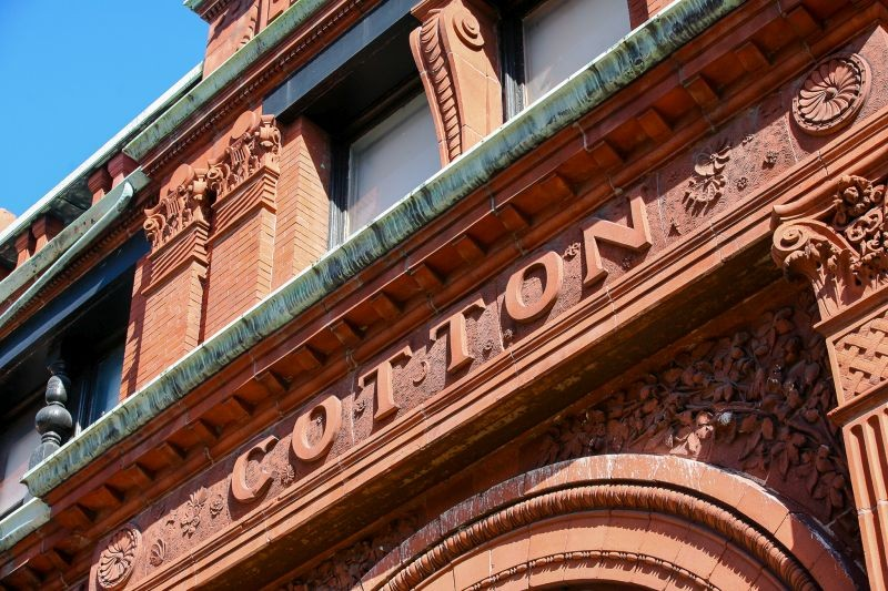 Details of the Cotton Exchange building that bear Adinkra symbols from Africa. - PHOTO BY JON WAITS