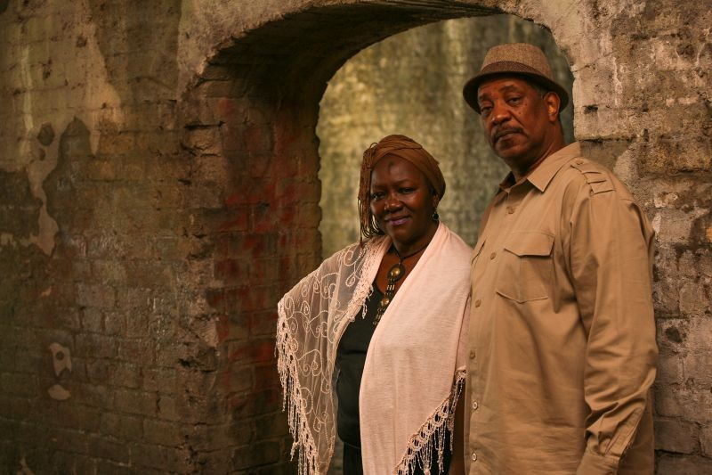 """Sistah Patt and her business partner and cousin """"Gullah Mike"""" Washington stand in the Cluskey Vaults, built in 1842 for unknown purposes. - PHOTO BY JON WAITS"""