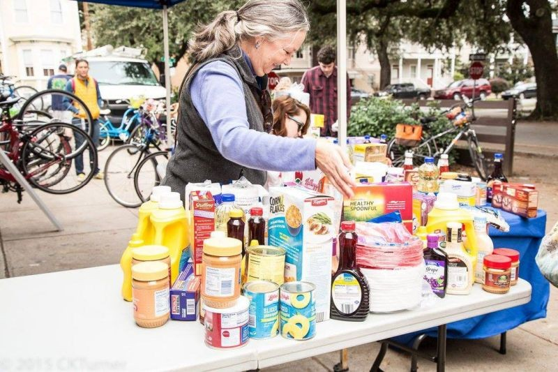 Savannah Bicycle Campaign volunteer Maggie Rickenbaker organizes food at Cranksgiving, a pedal-powered food drive benefiting Emmaus House.