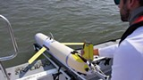 UGA Skidaway Institute research technician Ben Hefner launches a glider into the ocean. - Uploaded by Michael Sullivan