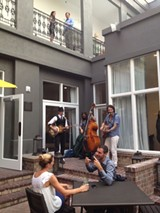 JIM MOREKIS - Waits & Co entertain in the courtyard of The Brice last week at the grand opening of the Kimpton property.