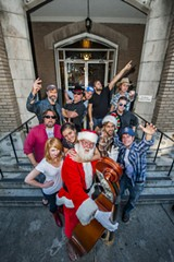 With John Pomeroy pulling Santa duty, the 2013 Hoedown crowd includes (clockwise from lower left): Britt Scott, Colleen Heine, Eric Britt, Craig Tanner, Stan Ray, Jeremy Hammons, Matt Eckstine, Jason Bible, Stuart Harmening, Zach Smith and Eric Dunn. Photo by Geoff L. Johnson, 4 p.m. Wednesday, Dec. 4 at American Legion Post 135, 1108 Bull St.
