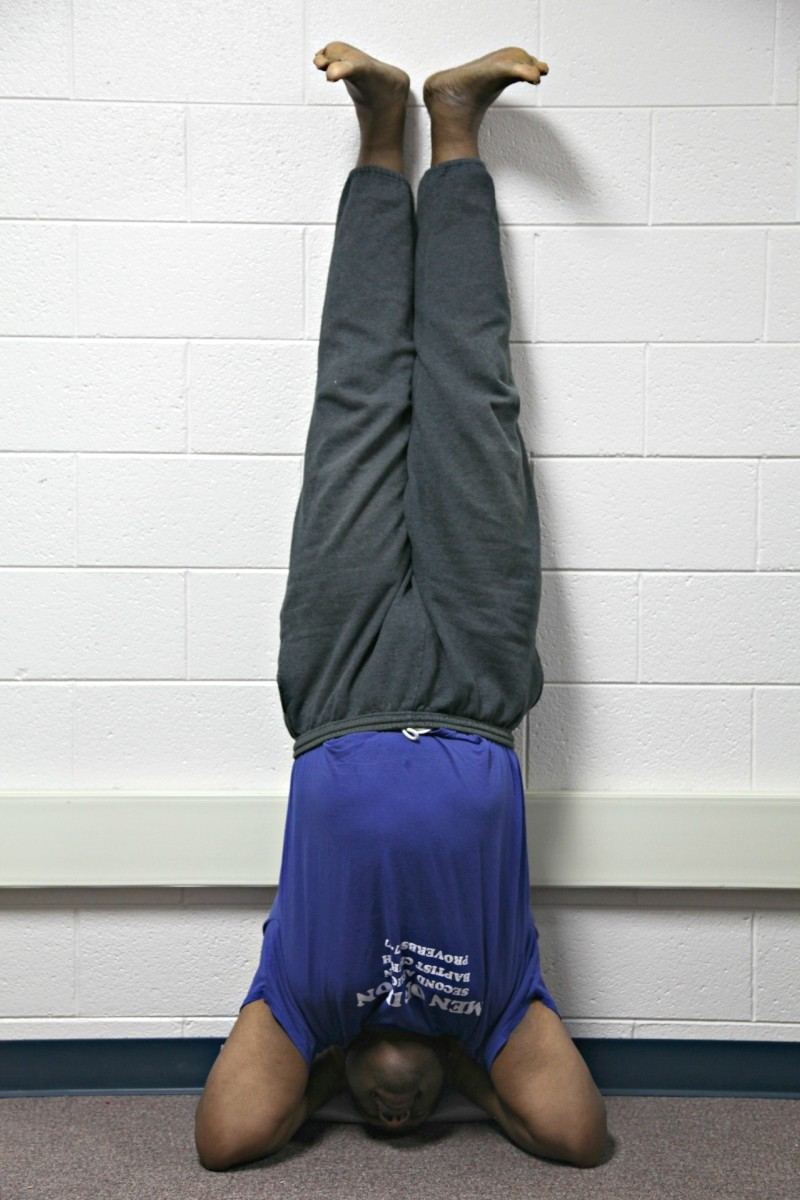 Yoga headstands are not for everyone and should be performed with the guidance of a certified yoga instruction. For Reginald Franklin, the headstand and other yoga postures improve strength, confidence, and balance.