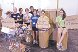 JEN BLATTY - Young volunteers work at Americas Second Harvest of the Coastal Empire